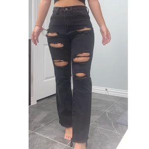 BLACK FLARED RIPPED JEANS
